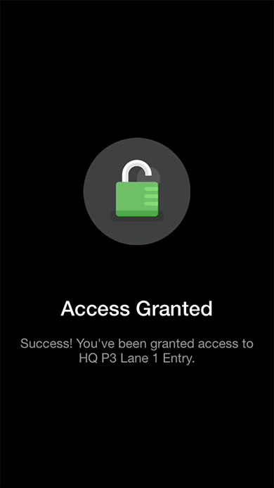 Screenshot showing an iPhone displaying an 'access granted' message after a user has opened the company parking garage.