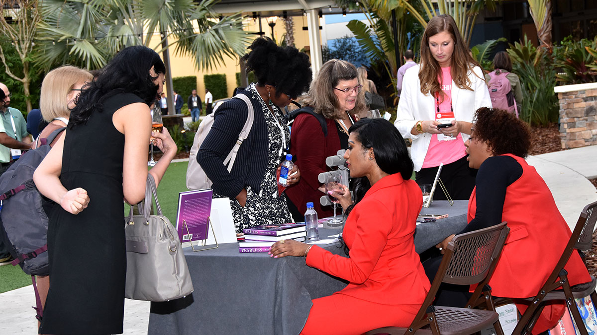 Women's networking event book signing